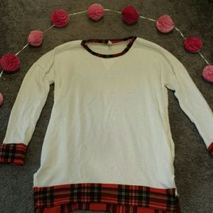 Plaid accented white top with elbow pads